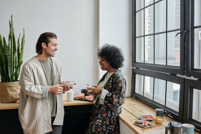 man and woman having breakfast